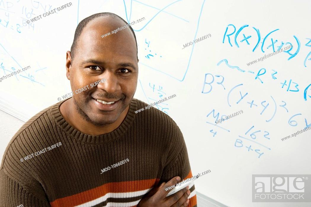 Stock Photo: Professor by whiteboard with equations portrait.