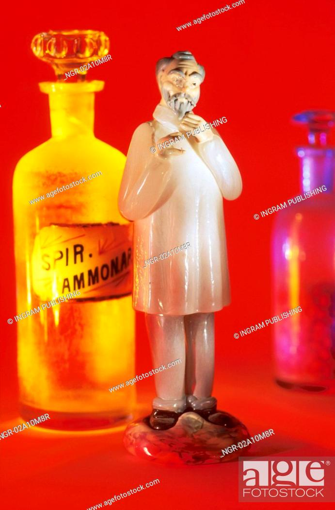 Stock Photo: Physician and Medicine Bottles.