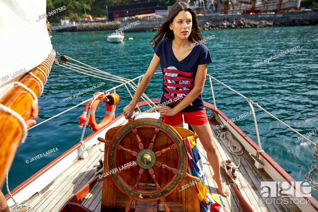 Stock Photo: Young woman with sailor clothes, Helm, Sailboat, Pasaia, Gipuzkoa, Basque Country, Spain, Europe.