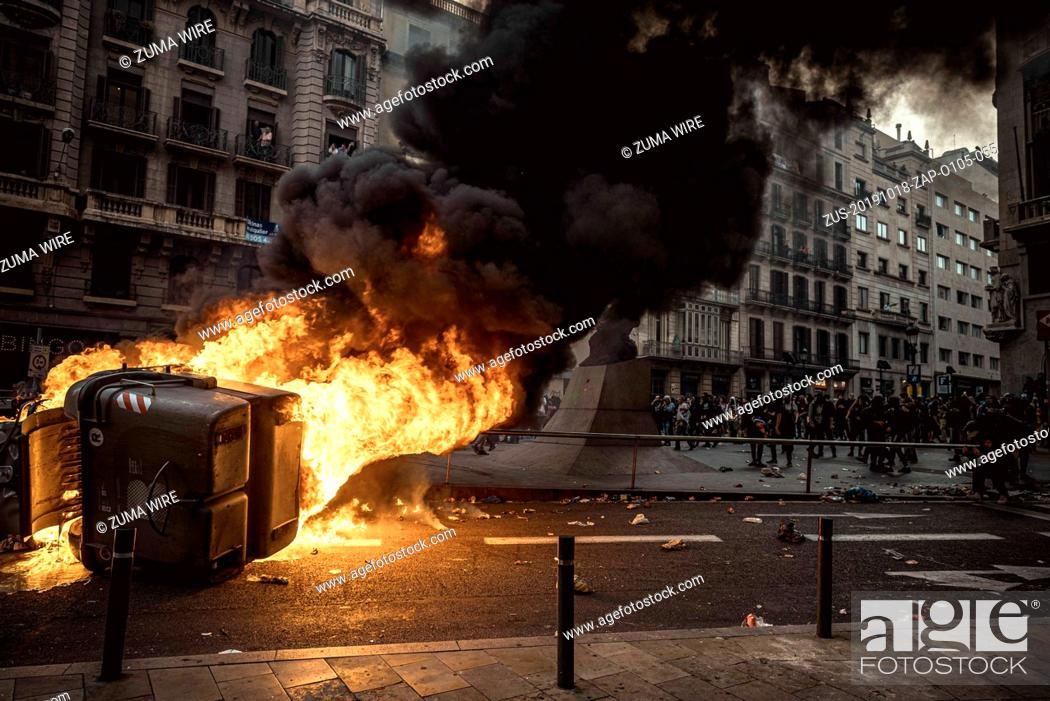 Stock Photo: October 18, 2019, Barcelona, Catalonia, Spain: A trash container burns as Striking Catalan pro-independence activists protest the Supreme Court's verdict.