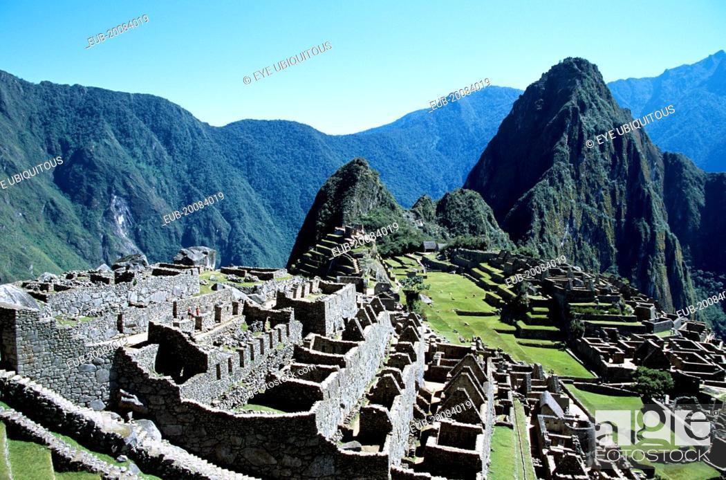 Stock Photo: Inca ruins and Huayna Picchu.