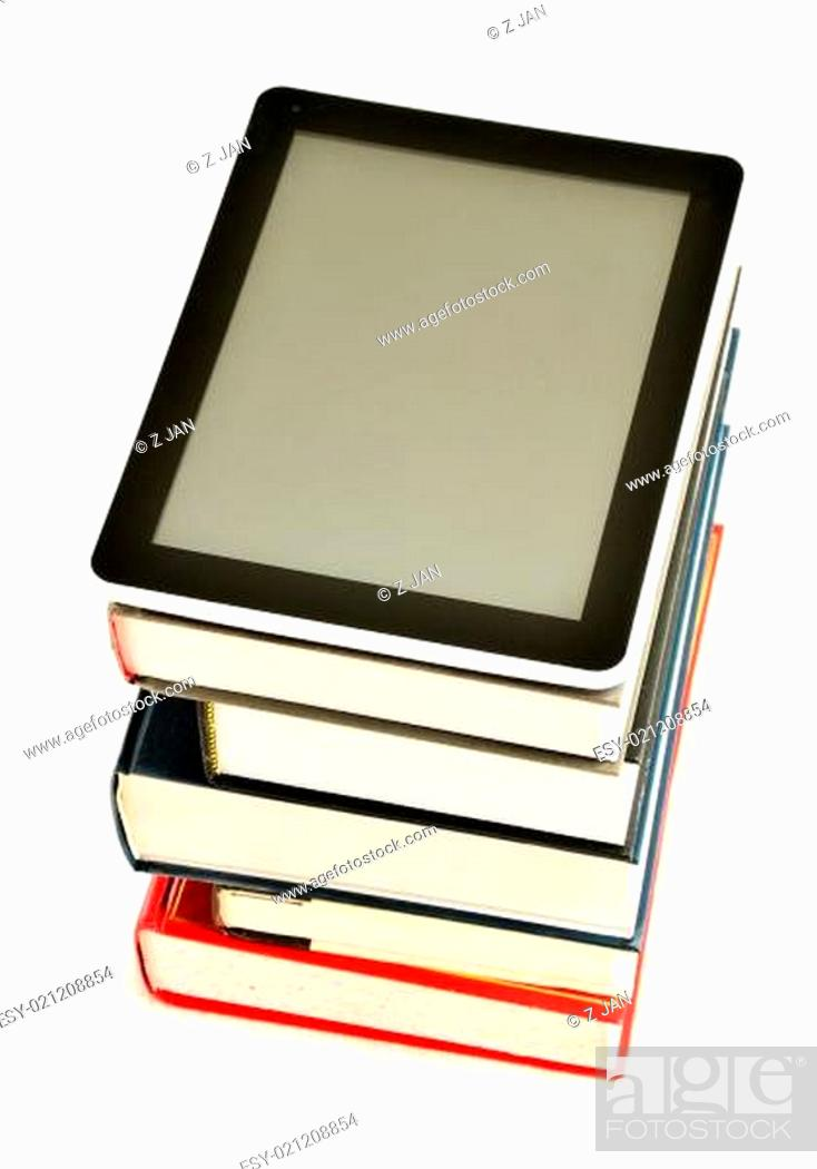 Imagen: Composition with books and tablet computer isolated on white.