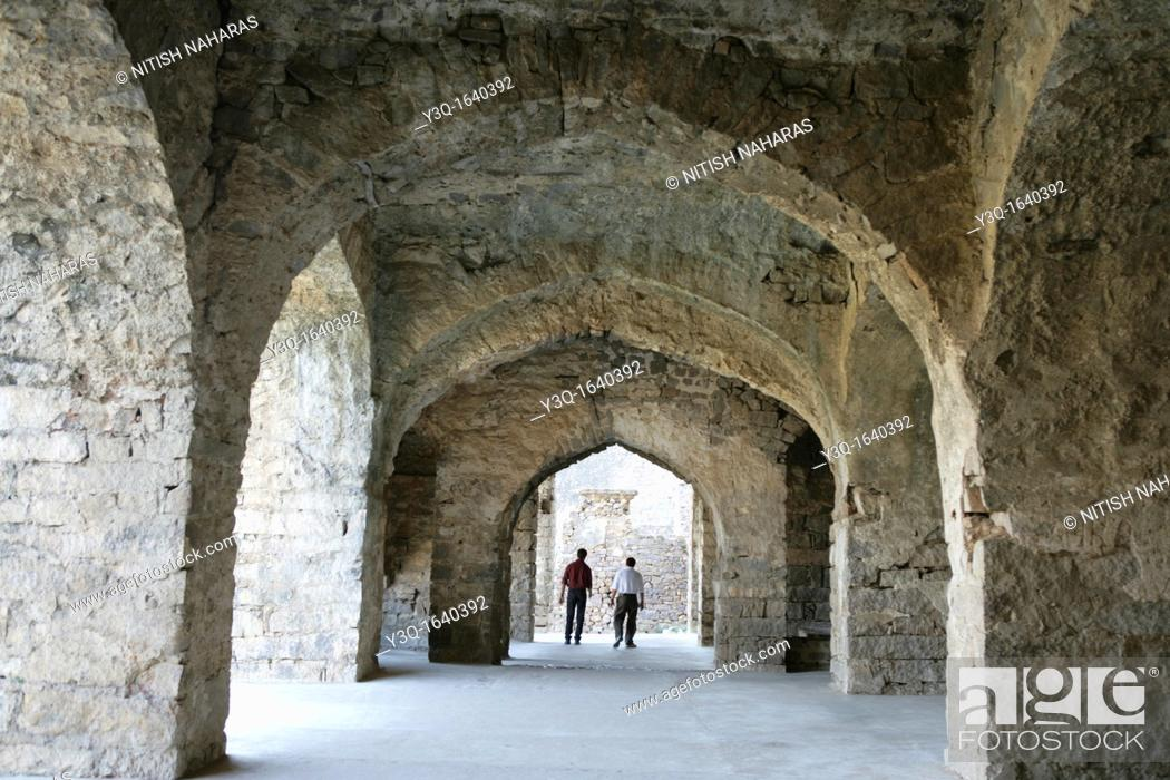 Stock Photo: Discussing facts and fiction along corridors of Golconda Fort in Hyderabad, India.