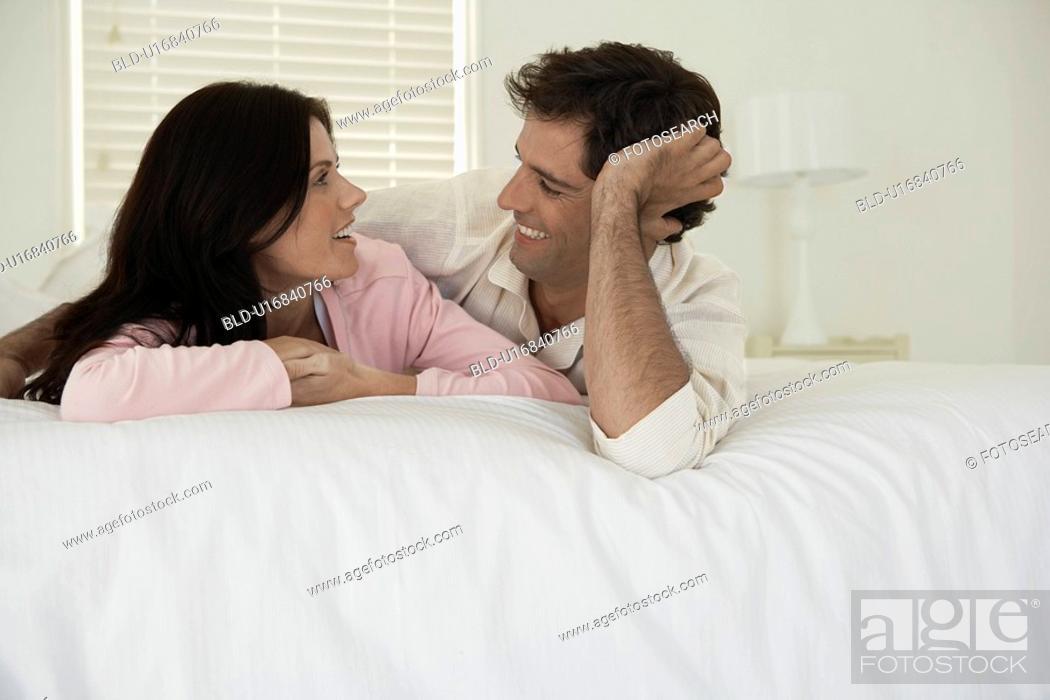 Stock Photo: Couple lying on bed.