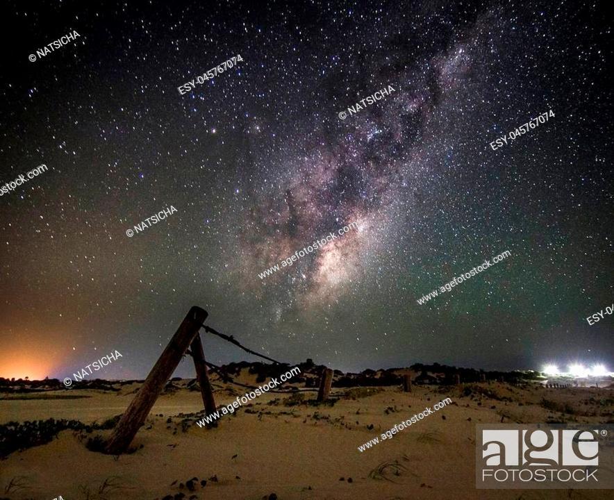 Stock Photo: milky way galaxy in the starry night in sanddune.