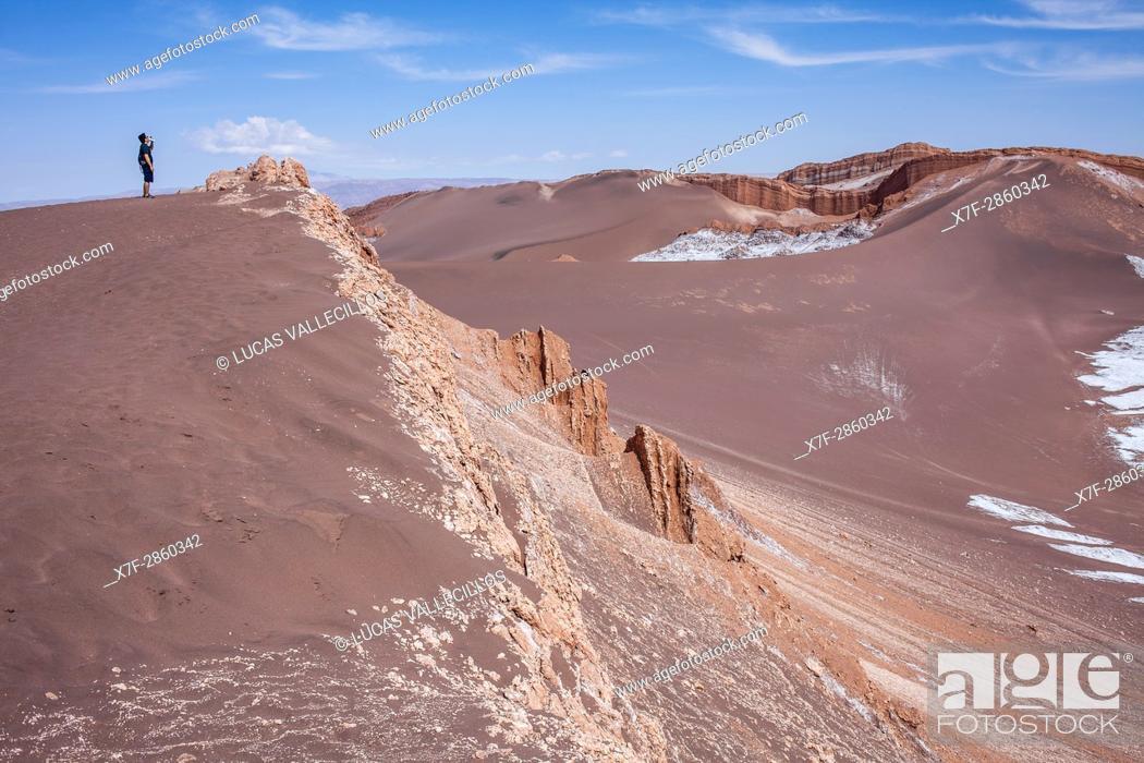 Stock Photo: Trekking, in Valle de la Luna (Valley of the Moon ) and salt deposited on the ground, Atacama desert. Region de Antofagasta. Chile.