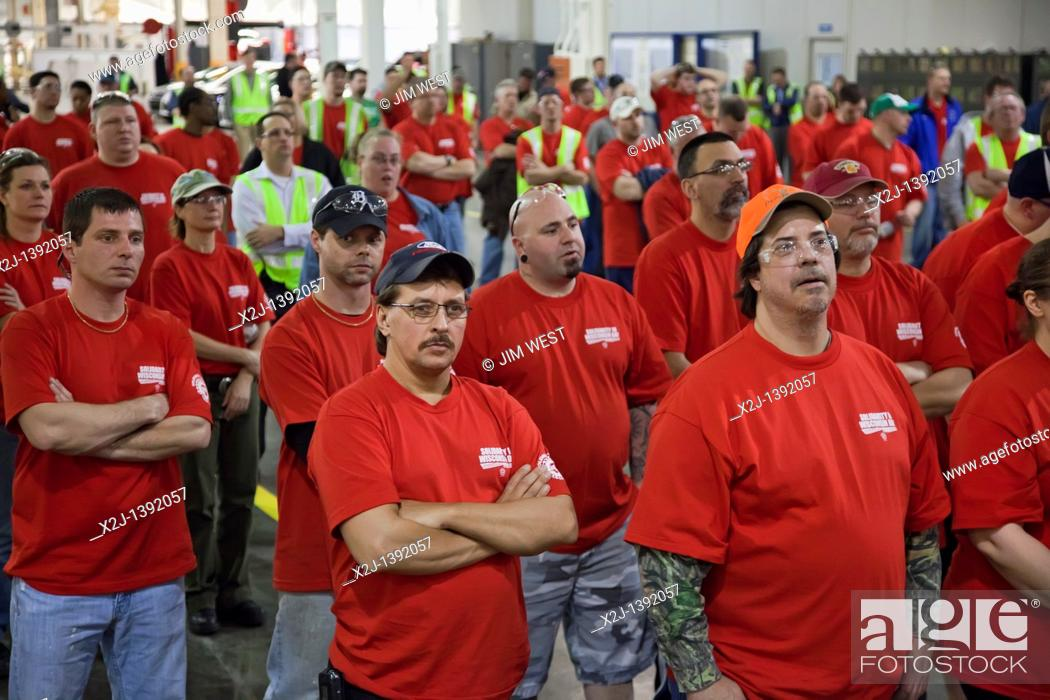 Stock Photo: Wayne, Michigan - Members of the United Auto Workers at Ford Motor Co 's Michigan Assembly Plant wear red t-shirts in solidarity with public employees in.