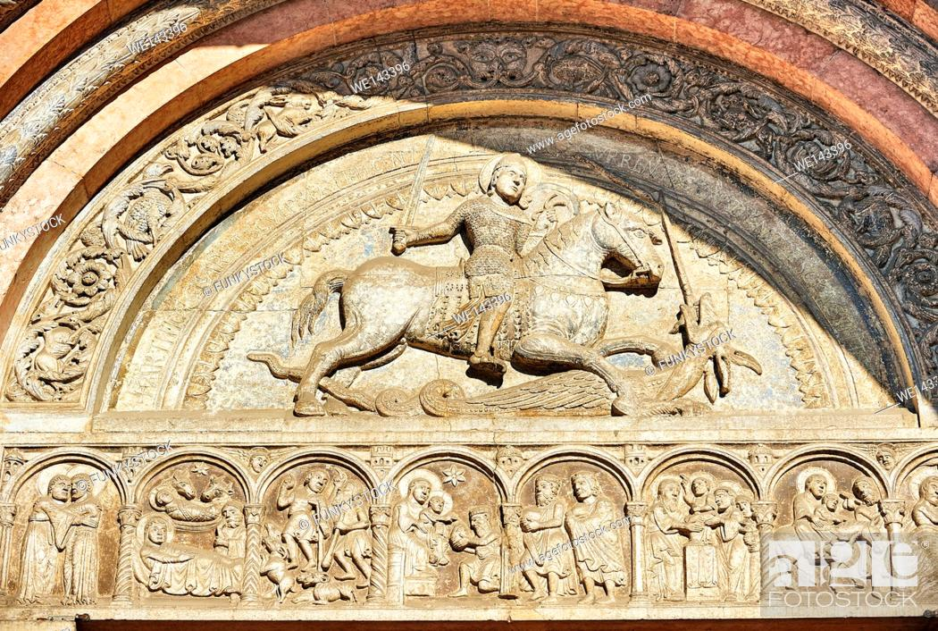 Stock Photo: Main portal lunette sculpture of St George, patron Saint of Farrara, killing the Dragon, the work of the sculptor Nicholaus.
