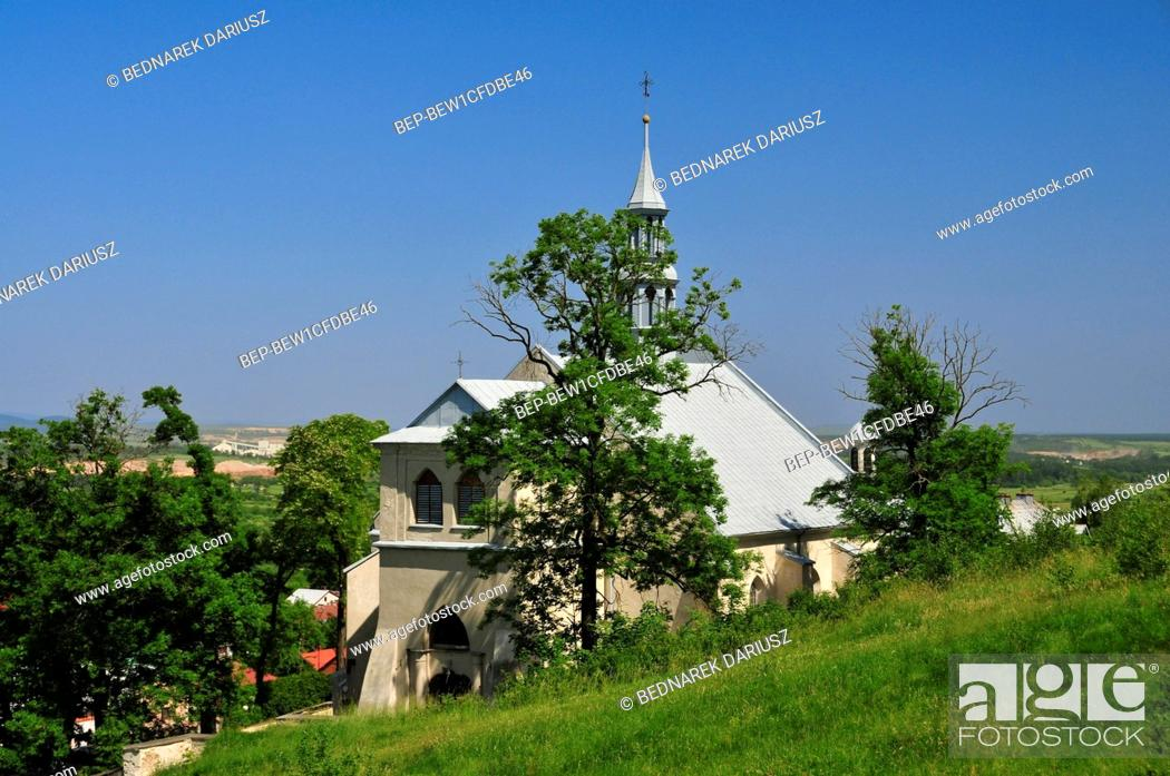 Stock Photo: The Parish Church of St Bartholomew is located at the rock terrace cut in the slope of the Zamkowa Mountain in Chentshin, Swietokrzyskie Voivodeship, Poland.