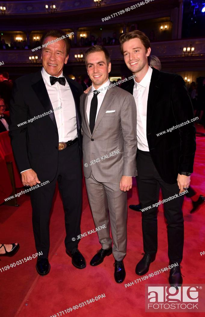 Arnold Schwarzenegger, his son Patrick and soccer player Philipp