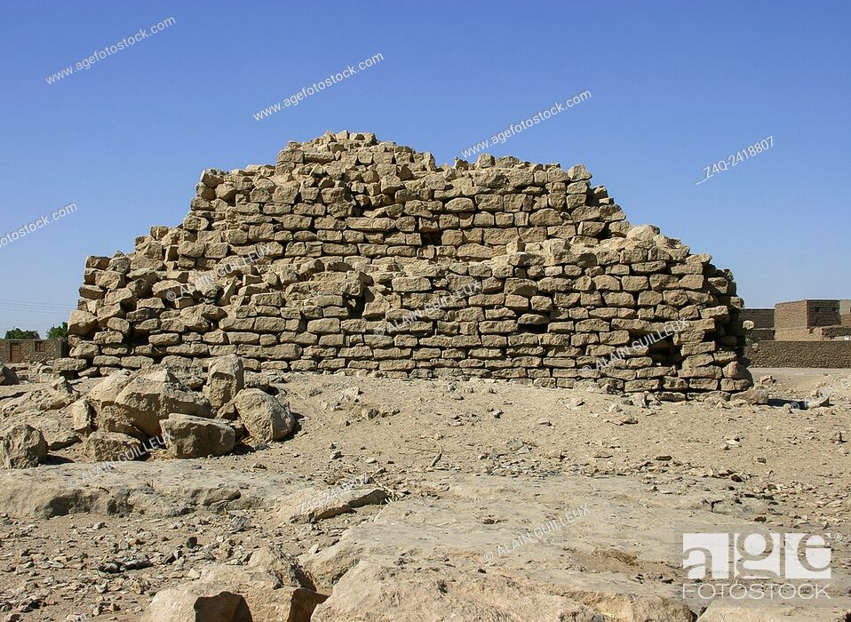 Stock Photo: Upper Egypt, El Kola near Hierakonpolis, provincial step pyramid, maybe built by pharao Houni, third dynasty. There's maybe a causeway in front of the pyramid.