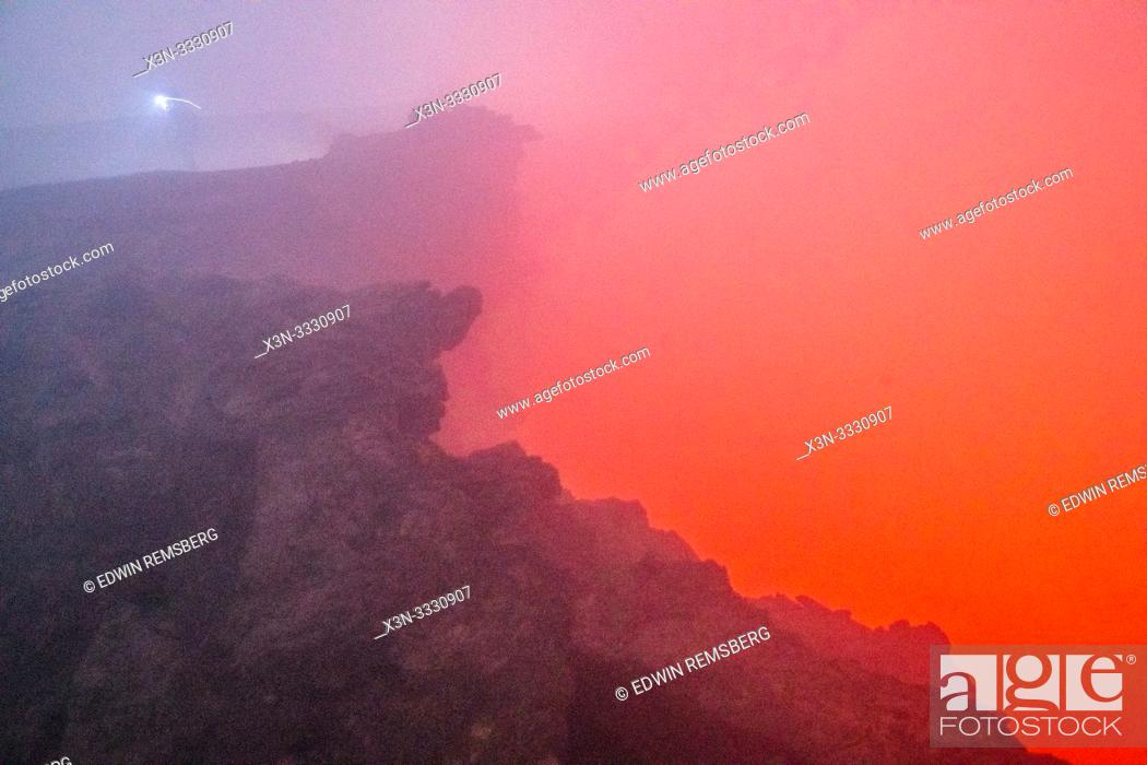Stock Photo: Apocalyptic look scenes as glowing red smoke pours out of Erta Ale Volcano, a continuously active basaltic shield volcano and lava lake in the Afar Region of.