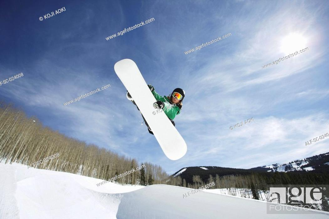 Stock Photo: Snowboarder Getting Vert.