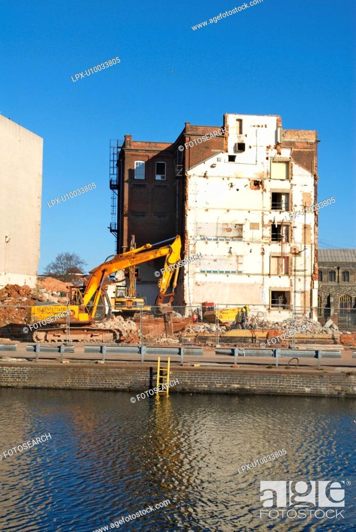 Stock Photo: Old factory being demolished for the regeneration of London Docklands area, UK.
