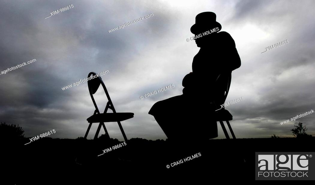Stock Photo: Undertaker sitting on a chair.