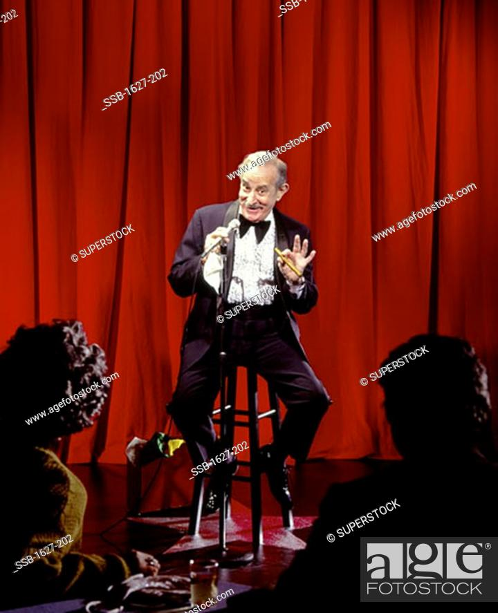 Stock Photo: Senior man performing on a stage.