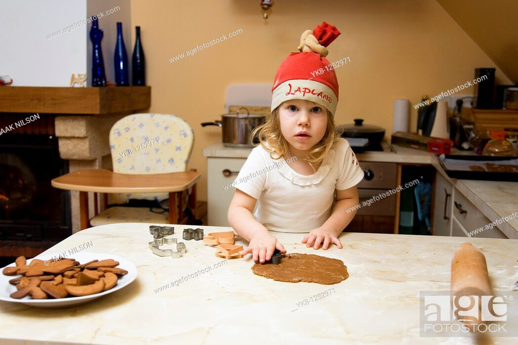Stock Photo: Two Years Old Girl Cooking Gingerbread.