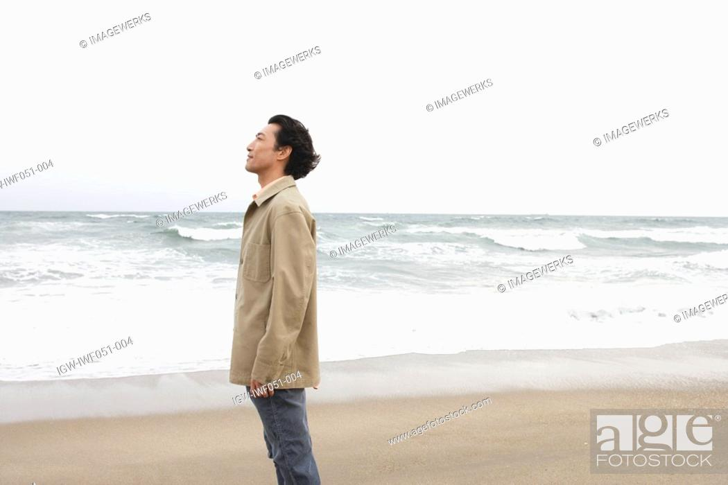 Stock Photo: Mature man at beach, side view.