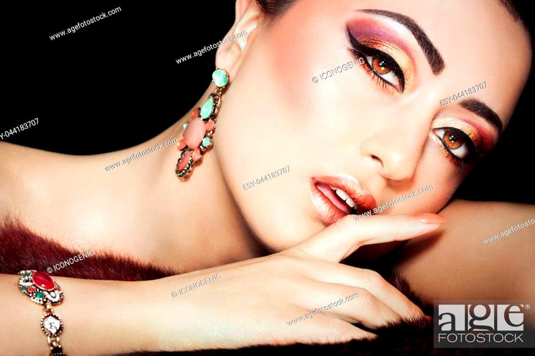Stock Photo: Beautiful exotic woman with excuisite Arabic glitter based makeup.