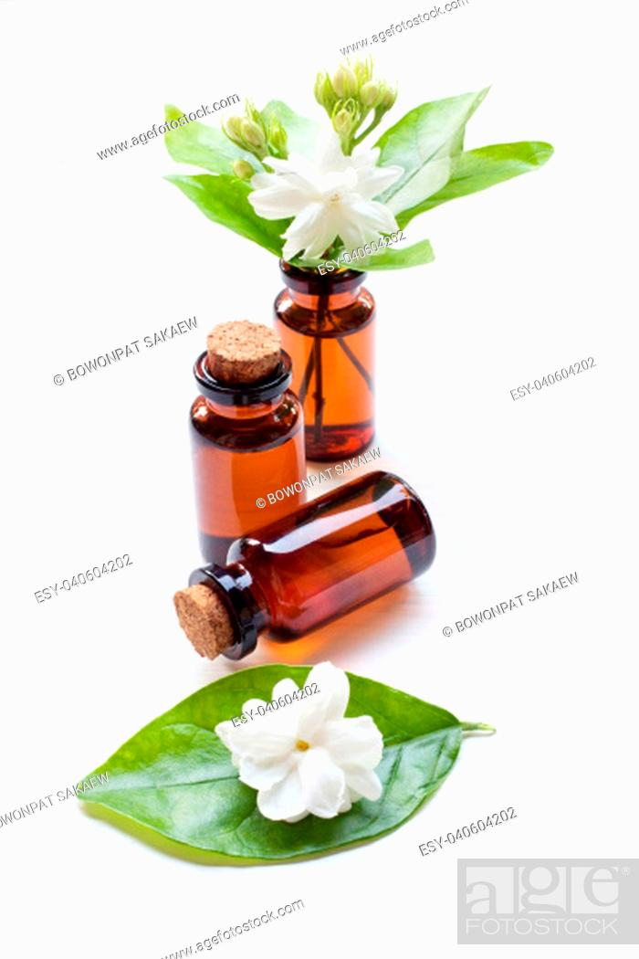 Imagen: Essential oil with jasmine flower on white background.