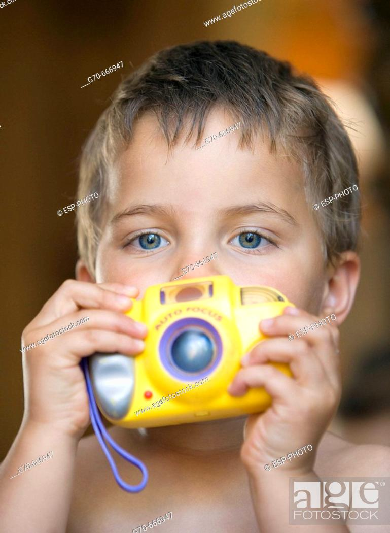 Stock Photo: Young boy taking picture.