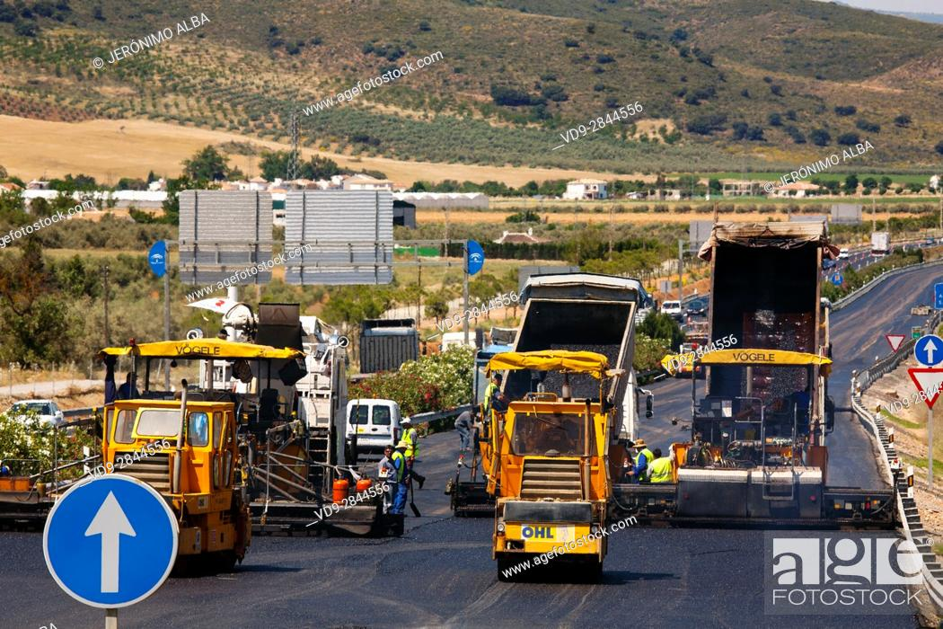 Stock Photo: Industrial truck laying asphalt on road in construction. Andalusia Spain, Europe.