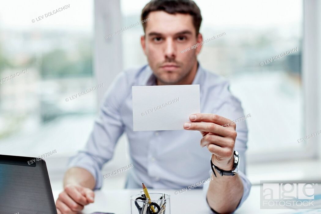 Stock Photo: business, people, announcement and advertisement concept - businessman showing blank paper card at office.