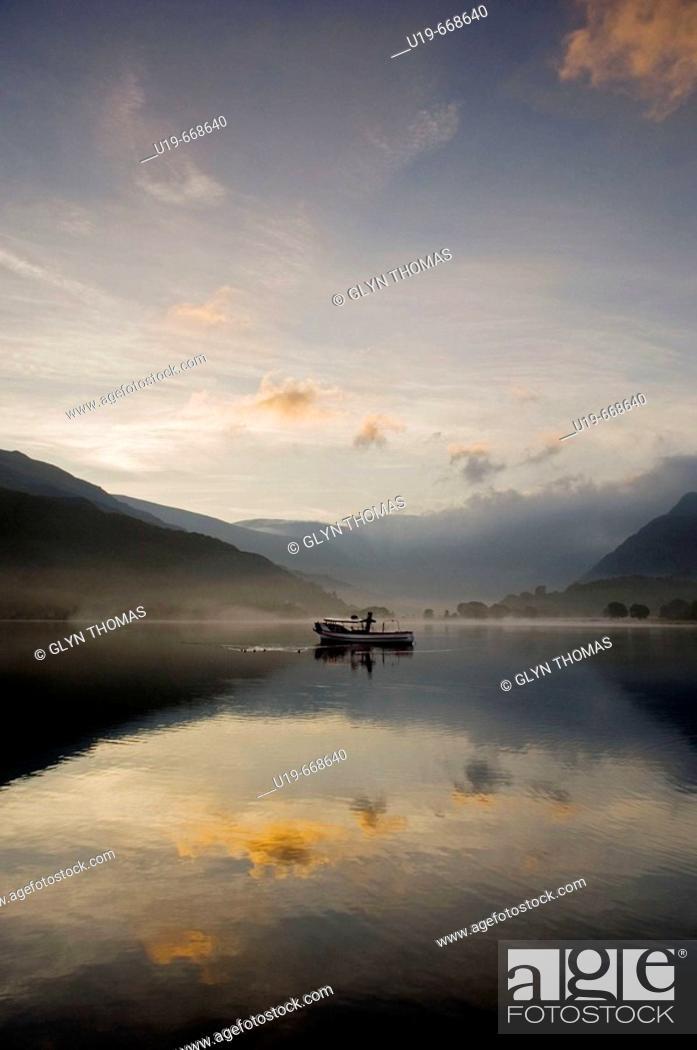 Stock Photo: Sunrise over Lake Padarn Llanberis, Snowdonia, North Wales, UK.
