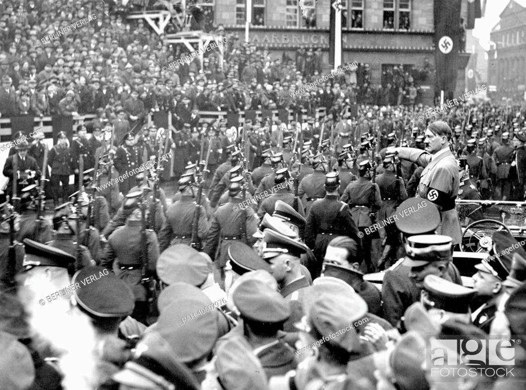 Stock Photo: View of a parade for Adolf Hitler (m) on the occasion of the handover of the Saar territory to the German Reich by the League of Nations, in Saarbrücken.