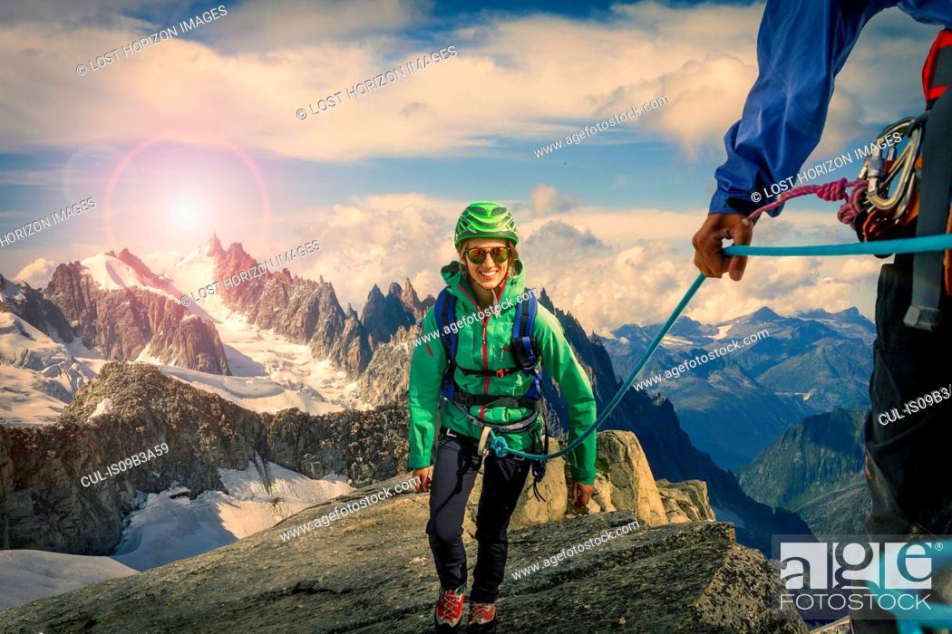 Stock Photo: Climbing couple climbing ridge at Mont Savoie, France.