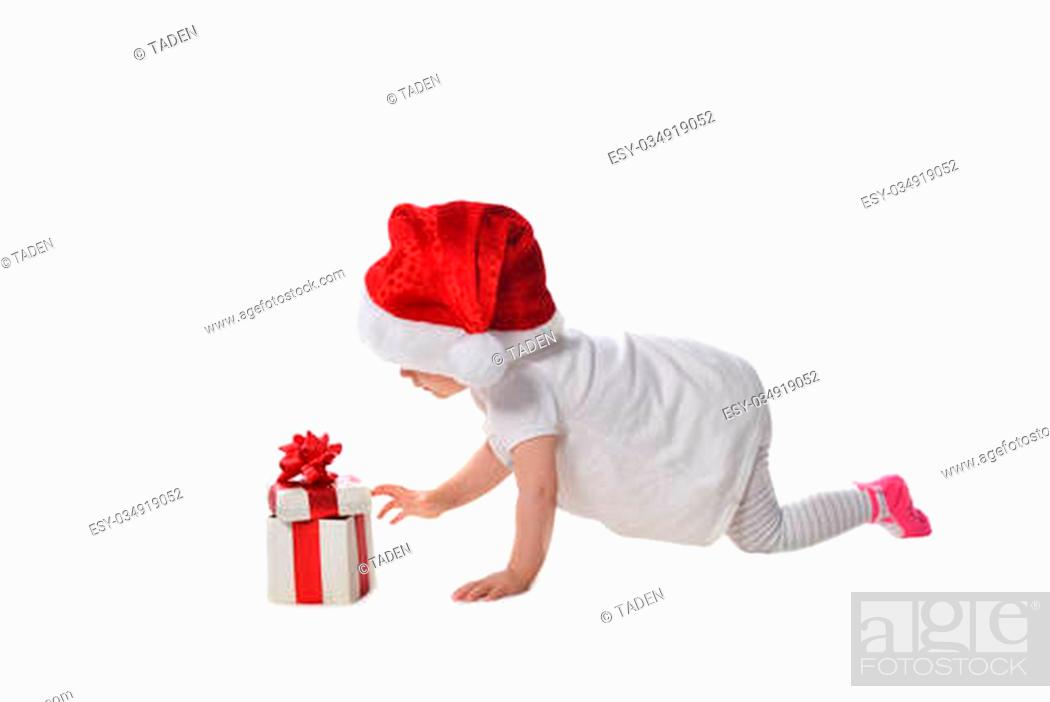 Stock Photo: adorable baby girl in Santa hat with gift box.