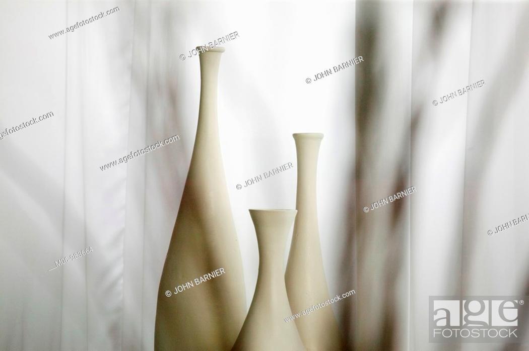 Stock Photo: Three White Bottles Behind Veil.