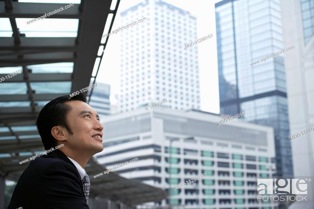 Stock Photo: China Hong Kong business man looking at cityscape side view.