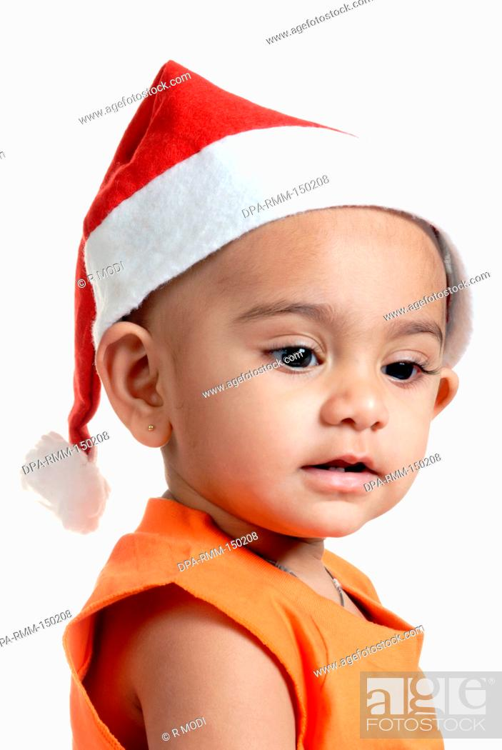 Stock Photo - Indian baby boy child in Christmas party red Santa Claus cap 95b5b1c1ace