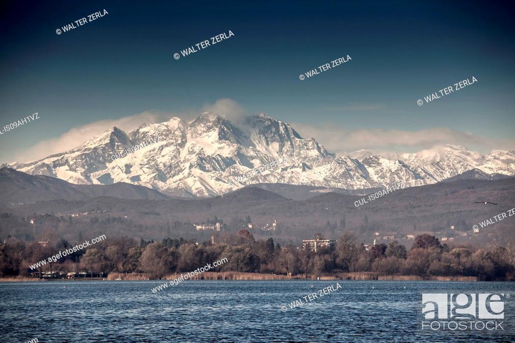 Stock Photo: Mount Rosa beyond Lake Maggiore, Arona, Italy.