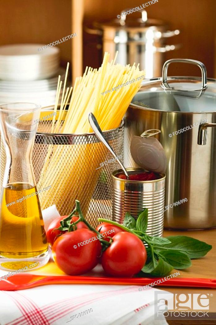 Stock Photo: Ingredients for spaghetti with tomato sauce and basil.