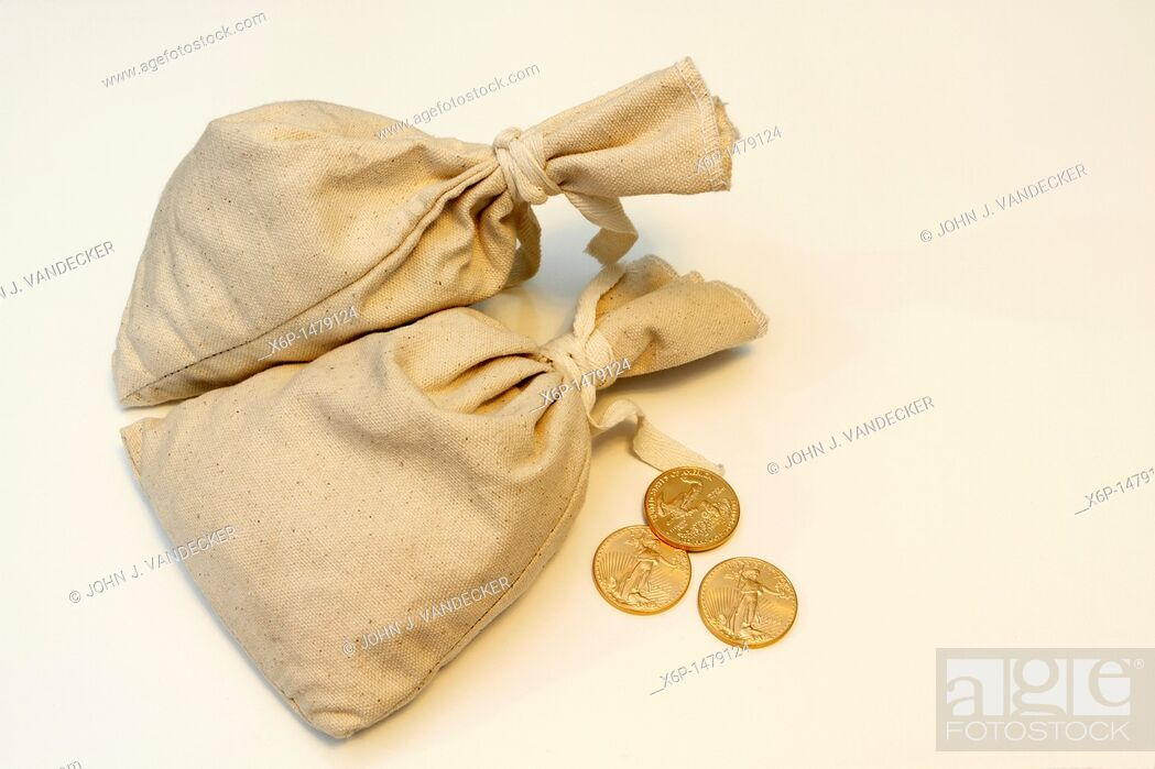 Stock Photo: Two money bags with three 1 oz American Eagle gold coins.