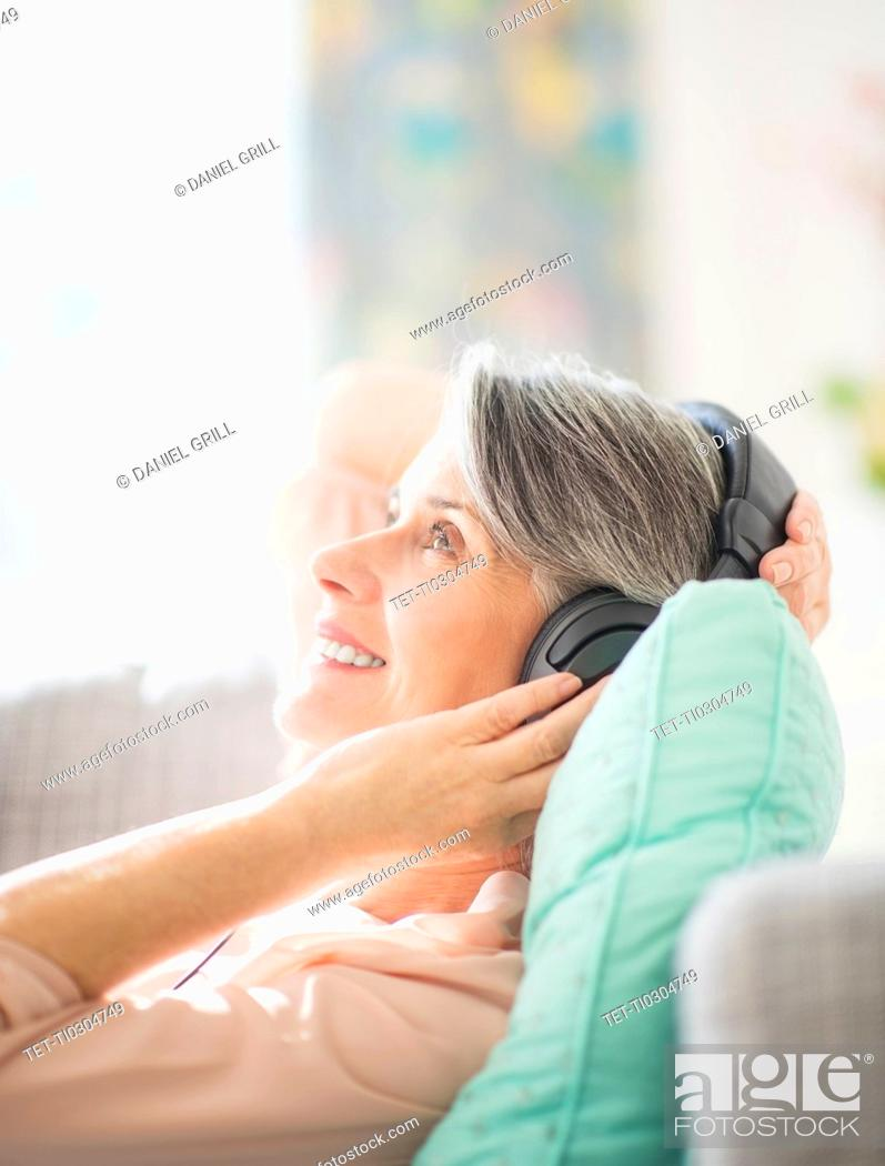 Stock Photo: Portrait of woman listening to music.