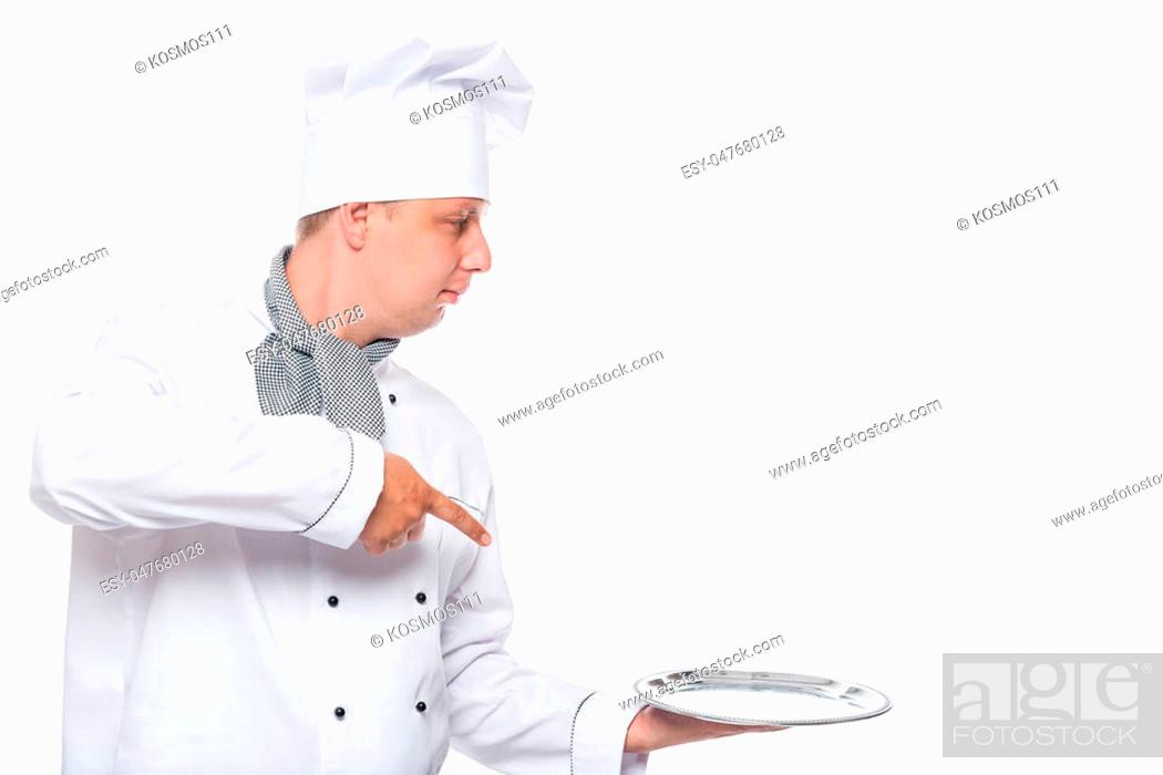 Photo de stock: Chef with a blank space on the right and a tray on a white background.