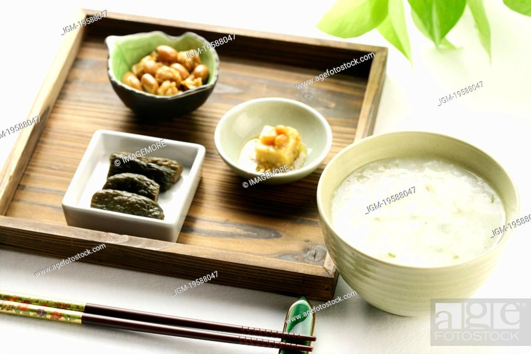 Stock Photo: Chinese Porridge with side dishes, Close Up.
