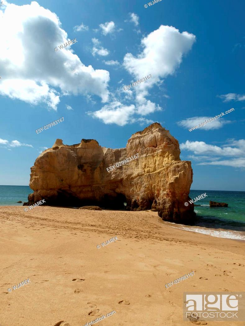 Stock Photo: A section of the idyllic Praia de Rocha beach on the Algarve region.