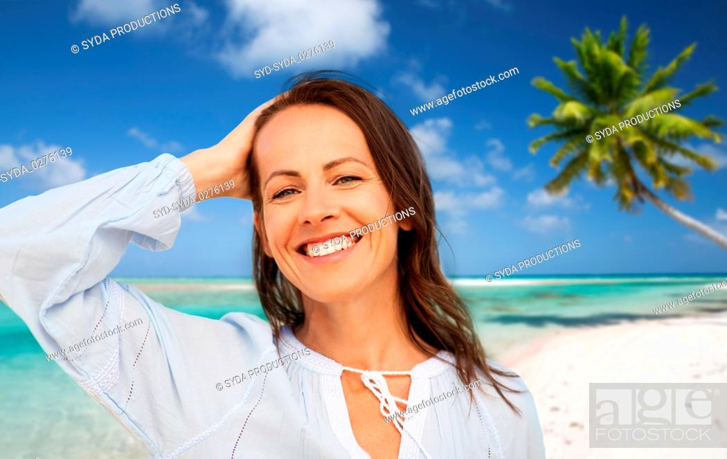 Stock Photo: happy smiling woman on summer beach.