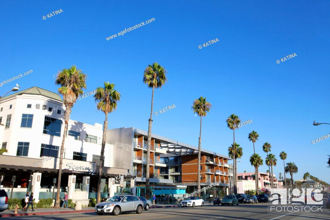 Stock Photo: Restaurants, shops and pedestrains along palm tree-lined, trendy Ocean Avenue in Santa Monica, California, USA.