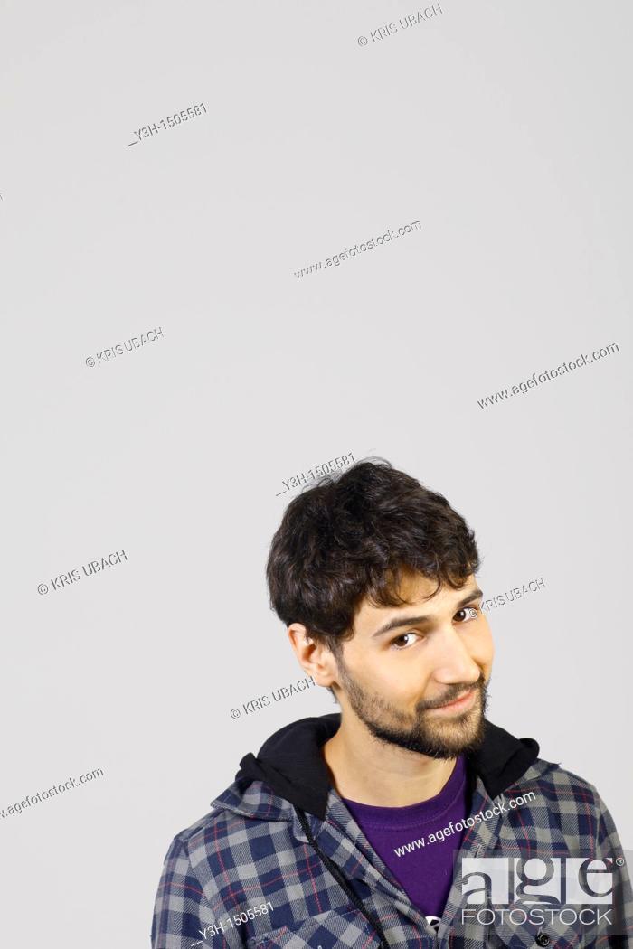 Stock Photo: Studio shot of young man, looking at camera.