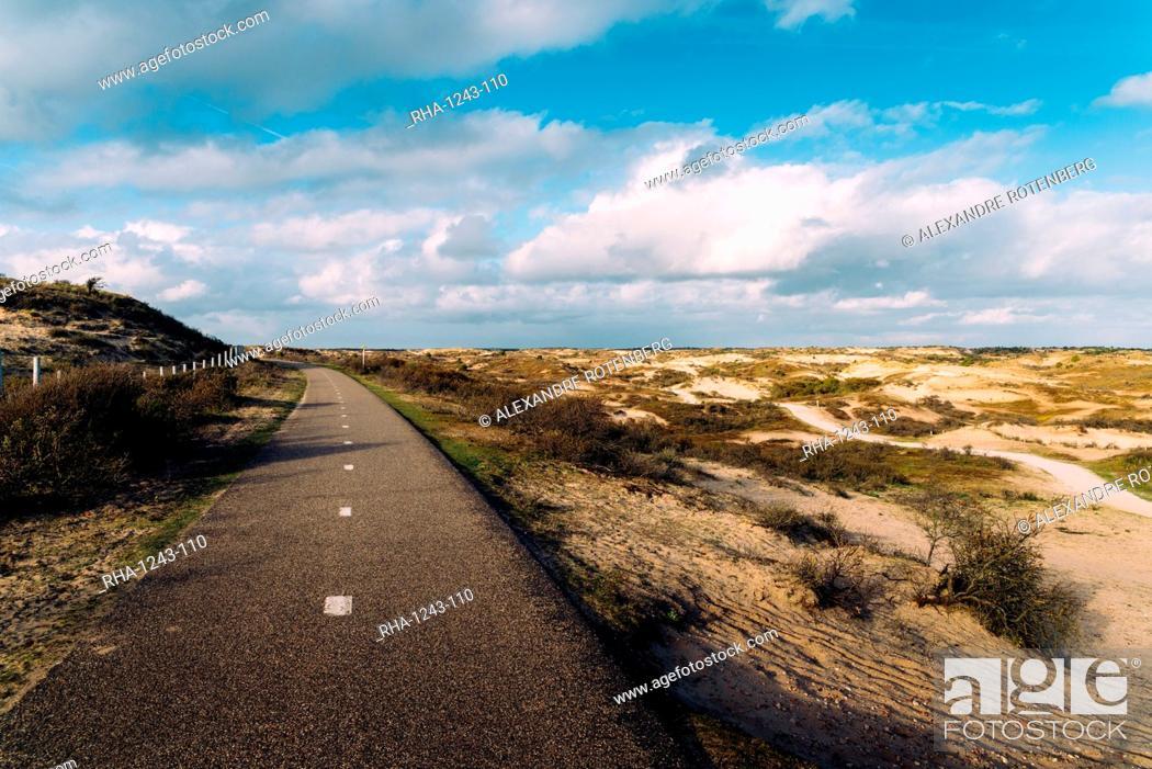 Stock Photo: A paved cycling path along the Dutch coast, Zeevort, The Netherlands, Europe.