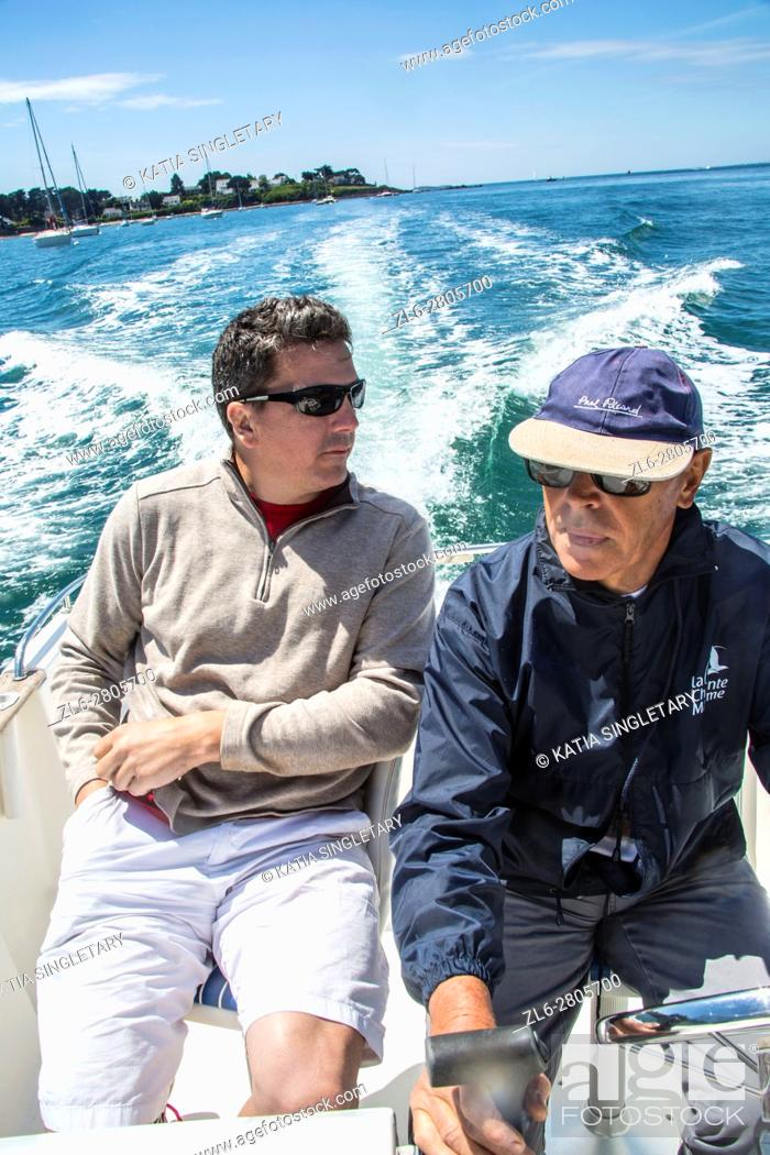 Stock Photo: Father in law and son having a guy time on a outing on the boat in the ocean, in Brittany, France.