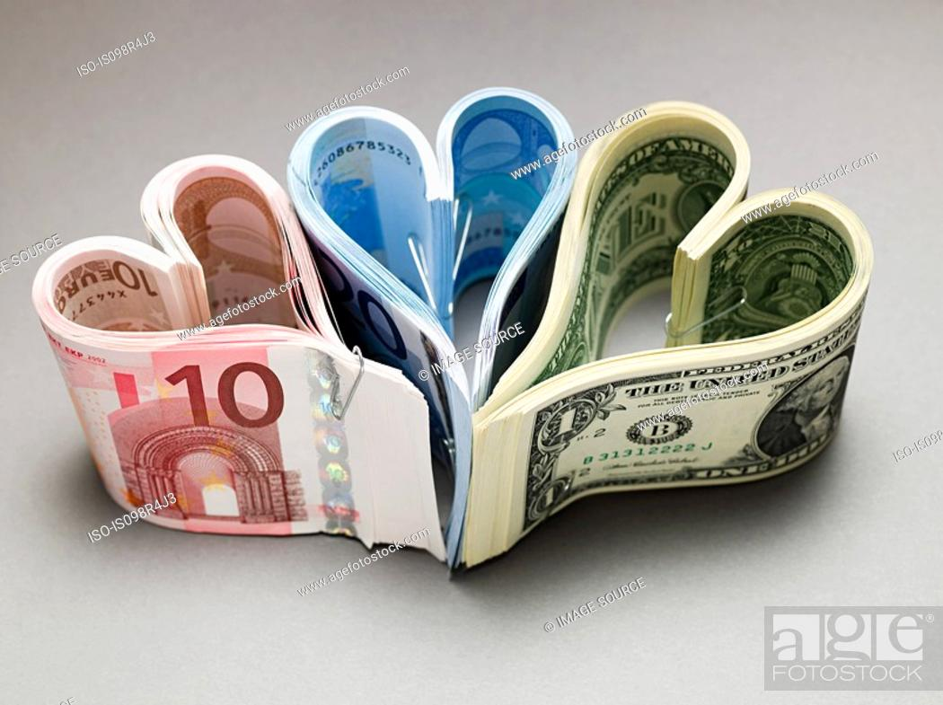 Stock Photo: Banknotes in heart shapes.