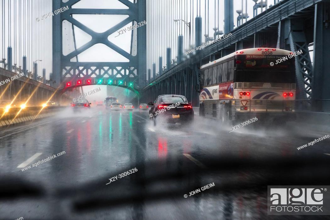 Stock Photo: Bridge traffic during a rain storm, Ben Franklin Bridge, Philadelphia, Pennsylvania.