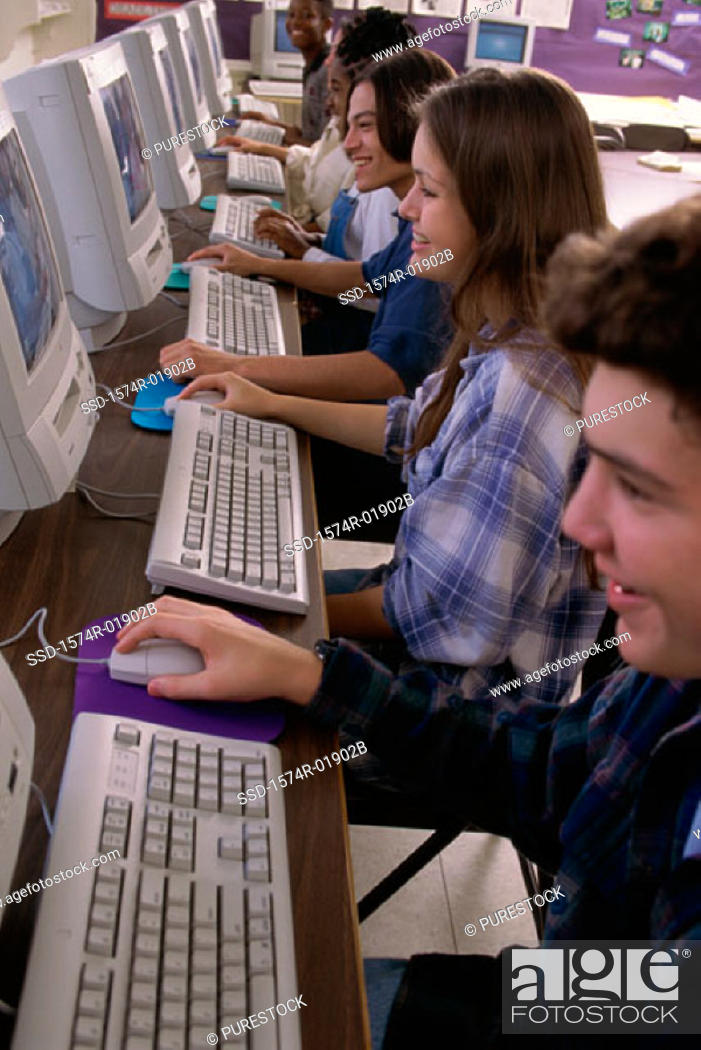 Stock Photo: High angle view of teenage students working in a computer room.