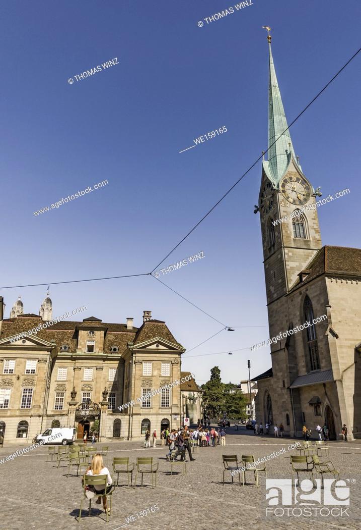Stock Photo: Chairs and tourists on Münsterho Square , Fraumünster church, Zurich, Switzerland.